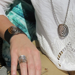 Black leather jewelry with silver detail in powerful design -