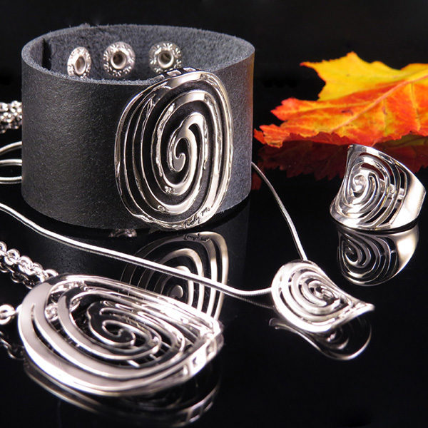 "Black leather jewelry with silver detail in powerful design - ""circle of life"""