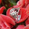 silverring med blommor