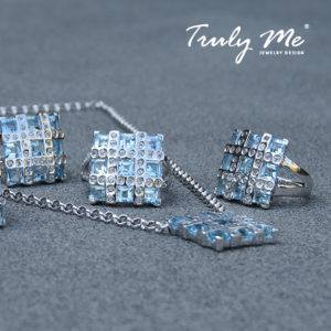 RIBBON silver jewelry set with blue topaz